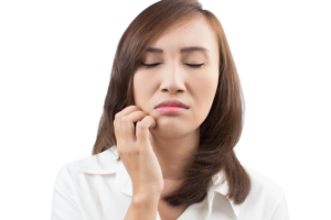 woman hold mouth after dental numbiness